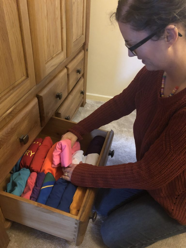 Louise Ladd from Order and Calm sorting out some clothes in drawers